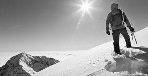 Mountaineer reaches pinnacle of snowy mountain