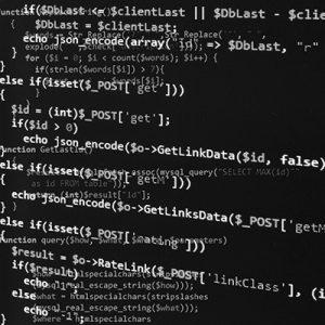 Programming code on black screen - software development